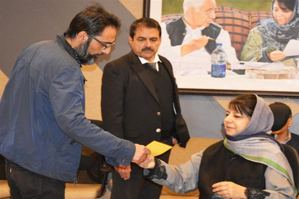 Mehbooba distributes appointment orders among visually impaired pellet victims