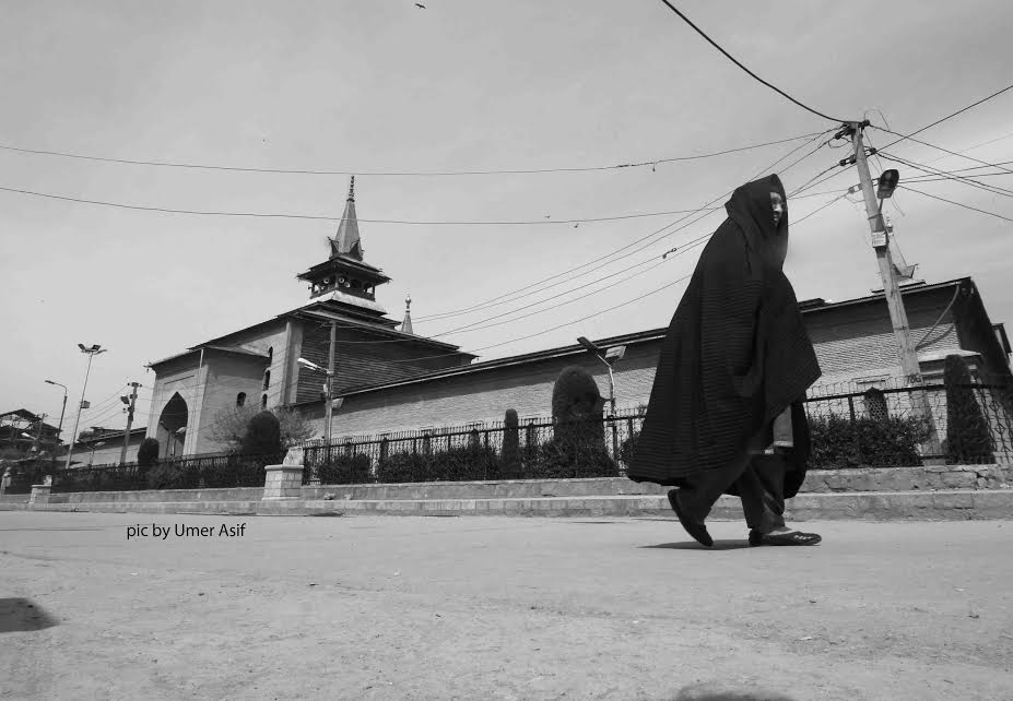 A Kashmiri woman donning Afghani Burqa strolls outside the traditional grand Mosque of Kashmir built in 14th century AD. (Pic by Umer Asif/KNS)