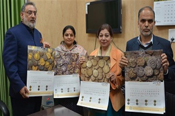 Dr Haseeb Drabu unveils JK's first Coinage Calendar