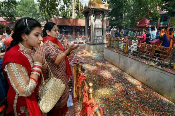 Pilgrims throng Tikker kup, Baderkali Handwara shrine on Kheer Bhawani