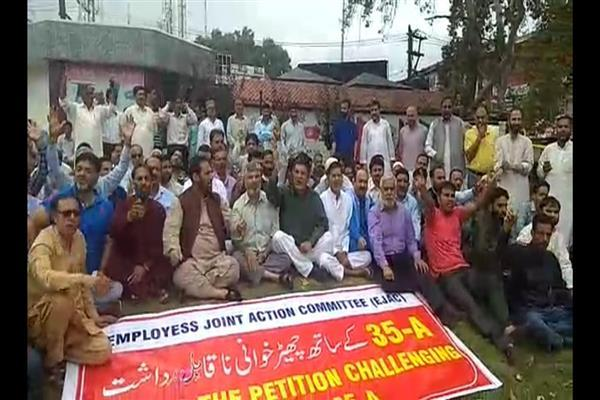 EJAC holds peaceful sit in protest against tampering with Article 35A