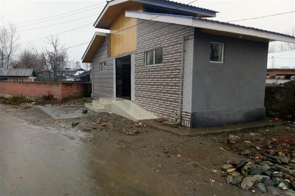 Toilet complex built in violation comes under road widening at Watergam Rafiabad