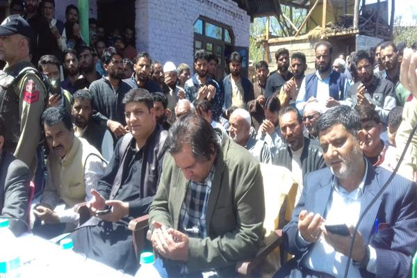 Sajad Lone visits slain PC workers family, promises to bear monthly expenses of family, ...